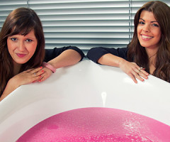 Two girls and a tub of slime